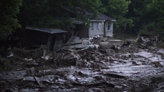 ELKVIEW, WV - JUNE 25: Mud and debris cover what was once a yard at home along Jordan Creek, off State Route 119, on June 25, 2016 in Elkview, West Virginia. The flooding of the Elk River claimed the lives of 26 people in West Virginia. (Photo by Ty Wright/Getty Images)