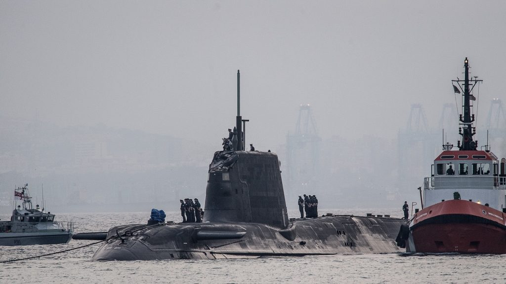 """A picture taken on July 20, 2016 in the port of Gibraltar shows the nuclear submarine HMS Ambush (C) making an unscheduled stop in Gibraltar due to a sustained damage to its conning tower after hitting a vessel. / AFP PHOTO / DM PARODY / RESTRICTED TO EDITORIAL USE - MANDATORY CREDIT """"AFP PHOTO / DM PARODY"""" - NO MARKETING NO ADVERTISING CAMPAIGNS NO SALES - DISTRIBUTED AS A SERVICE TO CLIENTS == NO ARCHIVE  / """"The erroneous mention[s] appearing in the metadata of this photo by DM PARODY has been modified in AFP systems in the following manner: [ADDITION OF FOLLOWING RESTRICTION: NO SALES] Please immediately remove the erroneous mention[s] from all your online services and delete it (them) from your servers. If you have been authorized by AFP to distribute it (them) to third parties, please ensure that the same actions are carried out by them. Failure to promptly comply with these instructions will entail liability on your part for any continued or post notification usage. Therefore we thank you very much for all your attention and prompt action. We are sorry for the inconvenience this notification may cause and remain at your disposal for any further information you may require."""""""