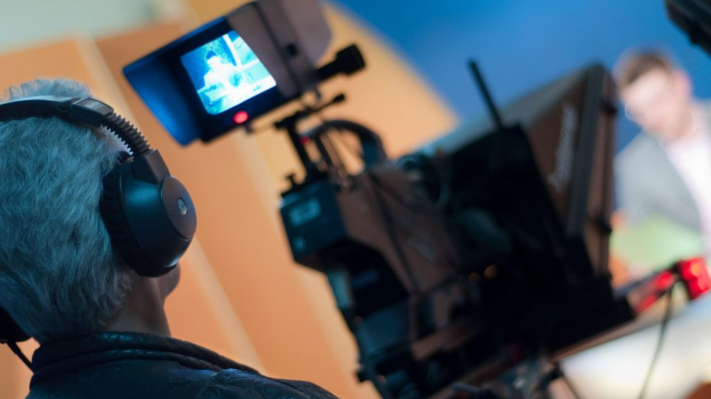 7602137 - video camera viewfinder - recording in tv studio - talking to the camera