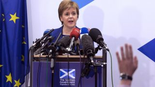 """Scotland's First Minister Nicola Sturgeon delivers a speech during a media conference at the Scotland House in Brussels as she is on a one day visit to meet with EU officials, on June 29, 2016. Scotland's First Minister Nicola Sturgeon said she was """"heartened"""" by her talks with EU officials today but said there was no """"automatic easy path"""" to protecting her country's status in the EU after Brexit. / AFP PHOTO / POOL / Geoffroy Van der Hasselt"""