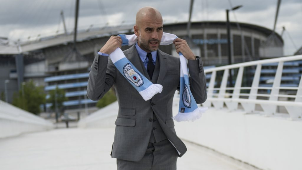 """Manchester City's Spanish football coach Pep Guardiola poses for pictures outside the Etihad Stadium in Manchester, northern England, on July 8, 2016.  Pep Guardiola has warned his Manchester City players that they have to prove themselves all over again following his arrival at the club. / AFP PHOTO / OLI SCARFF / RESTRICTED TO EDITORIAL USE. NO USE WITH UNAUTHORIZED AUDIO, VIDEO, DATA, FIXTURE LISTS, CLUB/LEAGUE LOGOS OR """"LIVE"""" SERVICES. ONLINE IN-MATCH USE LIMITED TO 45 IMAGES, NO VIDEO EMULATION. NO USE IN BETTING, GAMES OR SINGLE CLUB/LEAGUE/PLAYER PUBLICATIONS."""