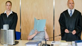 (FILES) This file photo taken on July 12, 2016 shows Defendant Andrea G (C) sitting between her lawyers Julia Gremmelmaier (L) and Till Wagler (R) as she waits for the opening of her trial at the district court of Coburg, central Germany. Andrea G and her husband Johann G are accused of murder and attempted murder of their children. In November 2015, police have discovered the bodies of eight dead babies in apartment that was inhabited by Andrea and Johann G. / AFP PHOTO / dpa / Daniel Karmann