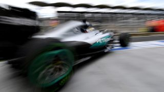 Mercedes AMG Petronas F1 Team's British driver Lewis Hamilton drives out of the pit lane during the first training session ahead of the Formula One Hungarian Grand Prix at the Hungaroring circuit near Budapest, on July 22, 2016.  / AFP PHOTO / ANDREJ ISAKOVIC