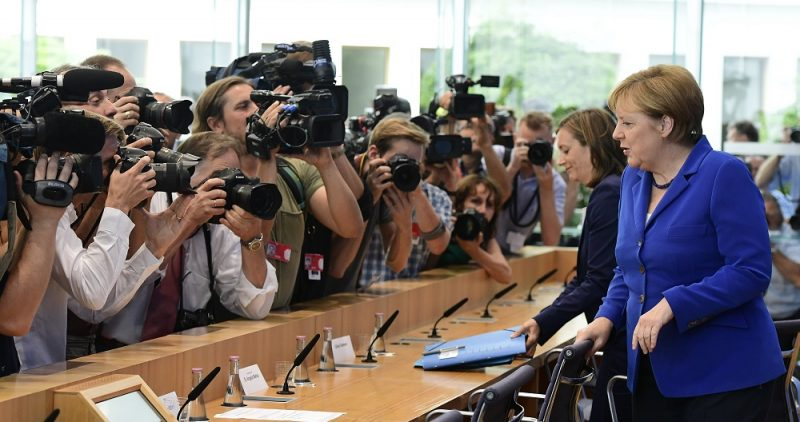 German Chancellor Angela Merkel arrives at a press conference in Berlin on July 28, 2016 Chancellor Merkel has interrupted her holiday to hold her annual wide-ranging press conference on domestic and foreign policy following a spate of attacks that have reignited criticism of her liberal stance on asylum. / AFP PHOTO / TOBIAS SCHWARZ