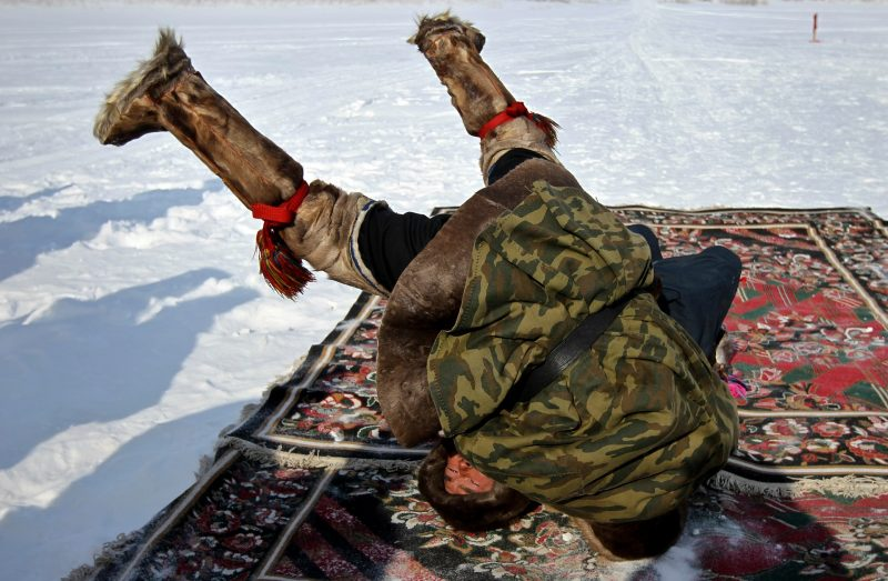 """Competition in traditional Nenets wrestling at the """"Day of the reindeer herdsman"""" festival in Schuchye village, Yamal-Nenets Autonomous District."""