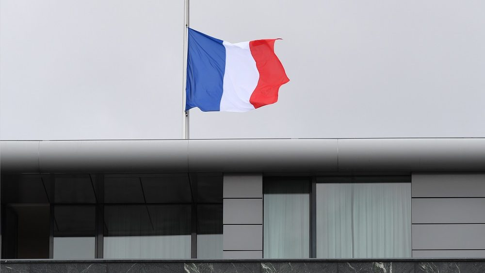 A French national flag flying at half-mast on the rooftop of the French embassy in Berlin,Germany, 15 July 2016. After the terrorist attacks in Nice, France, where reportedly more than 80 people died, a French and a European Union(EU)flag were also lowered to half-mast in front of the closed-off building. Photo:SOERENSTACHE/dpa