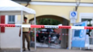 A member of the German police seen behind police tape near the crime scene inAnsbach,Germany, 25 July 2016. Twelve people were injured in an attack late on 24 July that may have had an Islamist background. The attacker was a 27-year-old refugee fromSyria, Bavaria's interior minister Herrmann said during a press conference. The young man who has on occasion undergone psychiatric treatment is suspected of attempting to set off a bomb with sharp metal pieces in his backpack at a music festival with about 2,500 visitors. However, he was denied access. Photo:Karl-Josef Hildenbrand/dpa