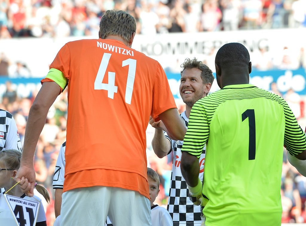 Dirk Nowitzki (l-r), SebastianVettel and Gerald Asamoah during the start of a charity soccer match with Dirk Nowitzki and Sebastian Vettel in Mainz, Germany, 27 July 2016. Similiar to Michael Schumacher's charity events, four times world champion Sebastian Vettel and his 'Nazionale Piloti' meet the 'Dirk Nowitzki All Stars' for a charity soccer match shortly before the Formula 1 Grand Prix in Hockenheim. PHOTO: TORSTEN SILZ/dpa