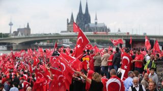 People with the Turkish flag are at a demonstration in support of Turkish President Erdogan in Cologne, Germany, 31 July 2016. Several thousand German Turks have attended a pro-Erdogan demonstration in Cologne. Photo: OLIVER BERG/dpa