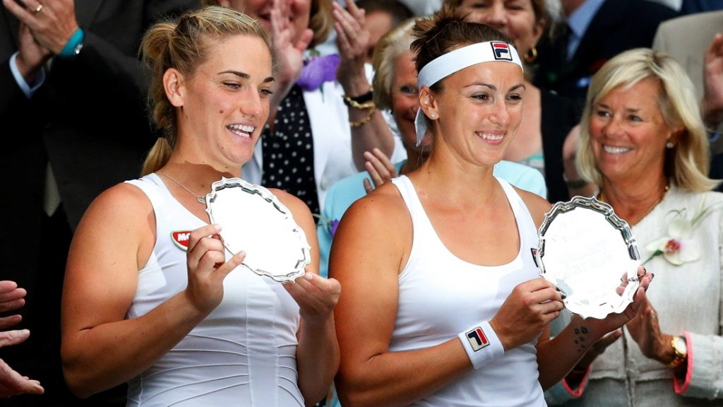 LONDON, UNITED KINGDOM - JULY 09: Timea Babos (L) of Hungary and Yaroslava Shvedova of Kazakstan receive their runners' up trophies after being beaten by Venus and Serena Williams of USA in the women's doubles final match of the 2016 Wimbledon Championships at the All England Lawn and Croquet Club in London, United Kingdom on July 09 2016.  Lindsey Parnaby / Anadolu Agency