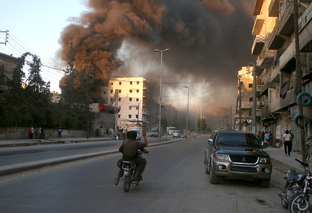 Smoke billows in the rebel-held Salihin neighbourhood of the Syrian northern city of Aleppo following a reported air strike on July 9, 2016. 