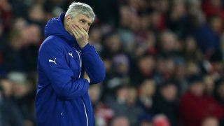 A dejected Arsene Wenger manager / head coach of Arsenal covers his face (Photo by AMA/Corbis via Getty Images)
