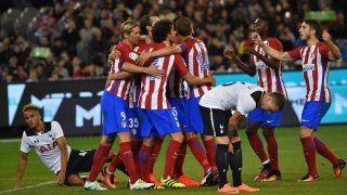 Atletico Madrid's Diego Godin (C-obscured) is congratulated by teammates after scoring late in the first half during the International Champions Cup football match between English Premier League team Tottenham Hotspur and Spanish club Atletico Madrid in Melbourne on July 29, 2016. / AFP PHOTO / Paul Crock / --IMAGE RESTRICTED TO EDITORIAL USE - STRICTLY NO COMMERCIAL USE--
