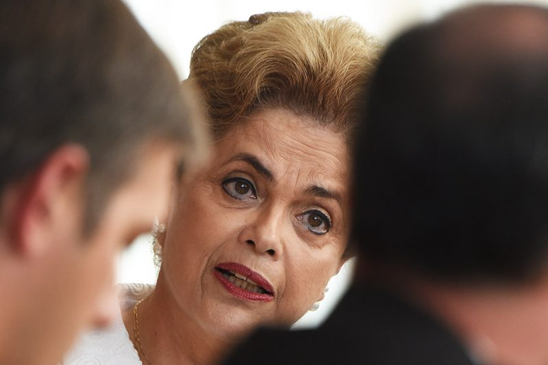 """Brazilian suspended President Dilma Rousseff gives a press conference with international media at the presidential residence Alvorada Palace in Brasilia on May 13, 2016.After months of the storm clouds massing, lightning struck President Dilma Rousseff on Thursday with Brazil's Senate ejecting her from office as it moves towards her likely impeachment. The fight, though, continues. Rousseff has vowed to reverse what she calls a """"coup"""" through legal defense, strident political opposition and with street protests by left-wing supporters of her Workers' Party. / AFP PHOTO / VANDERLEI ALMEIDA"""
