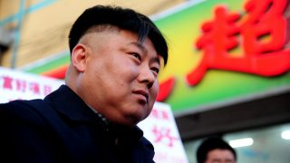 SHENYANG, CHINA - MARCH 22:  (CHINA OUT) Kim Jong Un look-alike Manchu Tuan, 32, looks on at his bbq street cart on March 22, 2014 in Shenyang, Liaoning Province of China. Manchu Tuan's meat cart has come a popular attraction ever since he cut his hair to resemble North Korean leader Kim Jong Un. (Photo by VCG/VCG via Getty Images)