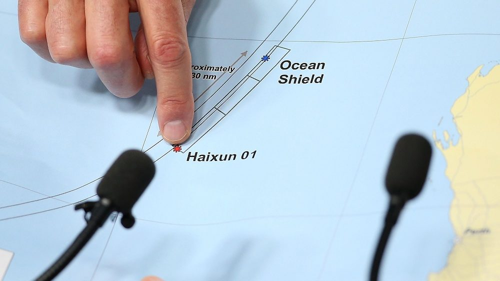 PERTH, AUSTRALIA - APRIL 07:  Air Chief Marshal Angus Houston (ret'd) holds a map outlining the current search areas of naval ships Ocean Shield and Haixun 01 during a press conference for the continuing search of missing Malaysia Airlines Flight MH370 at Dumas House on April 7, 2014 in Perth, Australia. Angus Houston confirmed today that the Australian naval vessel Ocean Shield has twice detected signals in the past 24 hours consitent with aircraft black boxes. The airliner disappeared on March 8 with 239 passengers and crew on board and is suspected to have crashed into the southern Indian Ocean.  (Photo by Paul Kane/Getty Images)