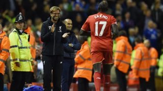 Liverpool's French defender Mamadou Sakho (R) celebrates with Liverpool's German manager Jurgen Klopp after scoring during the English Premier League football match between Liverpool and Everton at Anfield in Liverpool, north west England on April 20, 2016. / AFP PHOTO / PAUL ELLIS / RESTRICTED TO EDITORIAL USE. No use with unauthorized audio, video, data, fixture lists, club/league logos or 'live' services. Online in-match use limited to 75 images, no video emulation. No use in betting, games or single club/league/player publications.  /