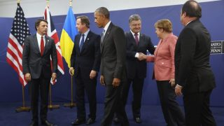 WARSAW, POLAND - JULY 09:  (From L to R)  Italian Prime Minister Matteo Renzi, British Prime Minister David Cameron, U.S. President Barack Obama, Ukrainian President Petro Poroshenko, German Chancellor Angela Merkel and Franch President Francois Hollande prepare to depart after posing for photographers following talks at the Warsaw NATO Summit on July 9, 2016 in Warsaw, Poland. NATO member heads of state, foreign ministers and defense ministers had gathered for a two-day summit that ended today.  (Photo by Sean Gallup/Getty Images)