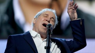 PHILADELPHIA, PA - JULY 25:  Singer-songwriter Paul Simon performs on stage during the first day of the Democratic National Convention at the Wells Fargo Center, July 25, 2016 in Philadelphia, Pennsylvania. An estimated 50,000 people are expected in Philadelphia, including hundreds of protesters and members of the media. The four-day Democratic National Convention kicked off July 25.  (Photo by Joe Raedle/Getty Images)