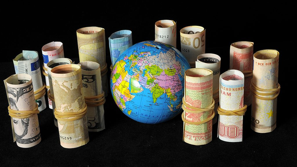 The Planet Earth and Rolled Money Financial Concept