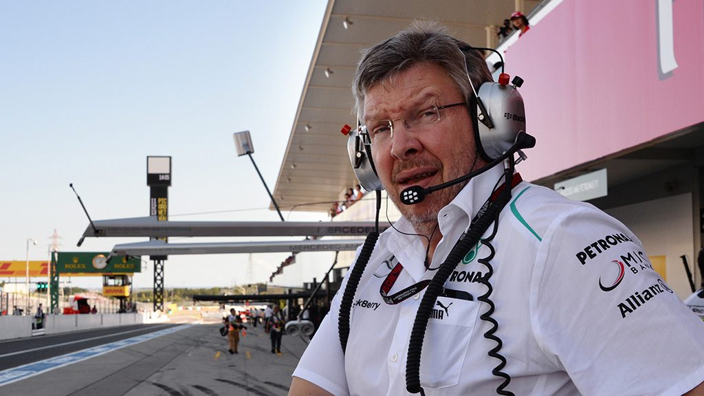 Mercedes team principal Ross Brawn of Britain walks in the pit lane prior to the second free practice session ahead of the Formula One Japanese Grand Prix in Suzuka on October 11, 2013.  AFP PHOTO / TOSHIFUMI KITAMURA / AFP PHOTO / TOSHIFUMI KITAMURA