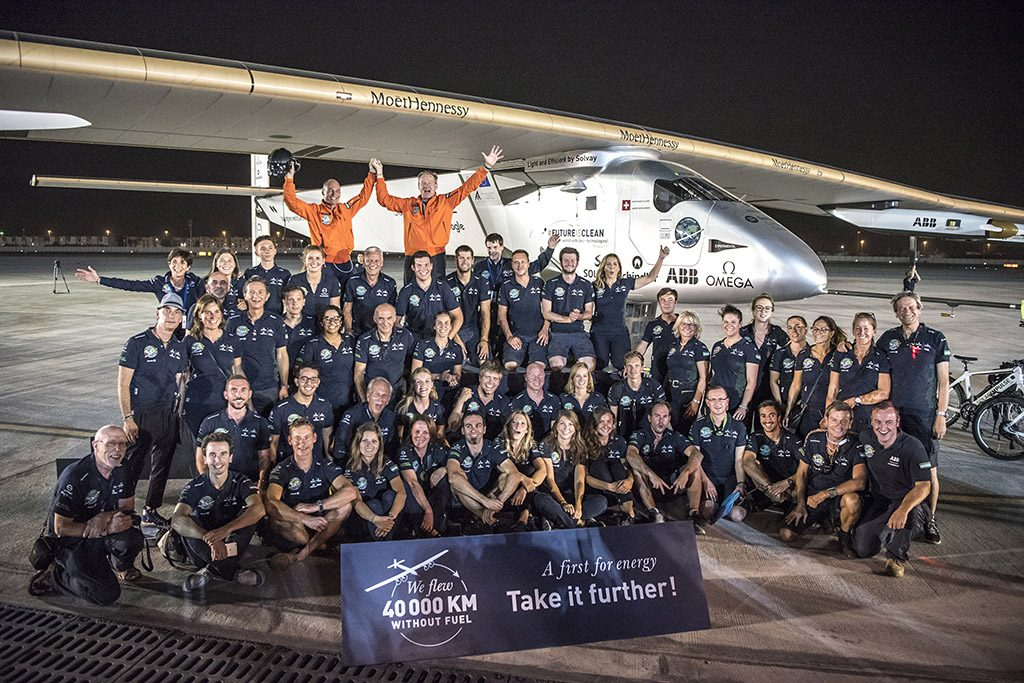 ABU DHABI, UAE - JULY 26:   In this handout image supplied by Jean Revillard, Swiss pioneers Bertrrand Piccard (top left) and Andre Borschberg (top right) celebrate with the Solar Impulse team after landing in Abu Dhabi to finish the first around the world flight without the use of fuel on July 26, 2016 in Abu Dhabi, UAE. The The 42,000 km journey was completed in 17-stages across four continents. The Solar Impulse 2 is equipped with 17,000 solar cells, has a wingspan of 72 metres, and yet weighs just over 2 tonnes. (Photo by Jean Revillard/Solar Impulse2 via Getty Images)