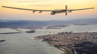 SAN FRANCISCO, CA - APRIL 23:  In this handout image supplied by Jean Revillard, Solar powered plane 'Solar Impulse 2', piloted by Swiss adventurer Bertrand Piccard, flys over the Golden Gate bridge in San Francisco, after a flight from Hawaii during its circumnavigation, before landing at Moffett Airfield in Mountain View in Silicon Valley, on April 23, 2016 in San Francisco, California. The Solar Impulse 2 is equipped with 17,000 solar cells, has a wingspan of 72 metres, and yet weighs just over 2 tonnes. (Photo by Jean Revillard via Getty Images)