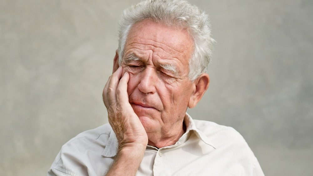 Old man trying to remember something