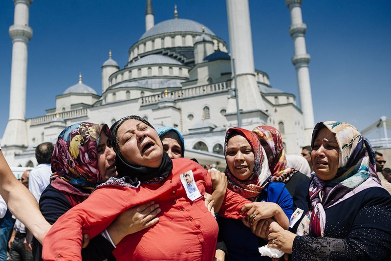 Women react during the funeral ceremony of Sehidmiz Murat Inci, victim of the coup attempt, at Kocatepe Mosque in Ankara on July 18, 2016.Support from the highest echelons in the army helped keep President Recep Tayyip Erdogan in power after the failed coup but July 15's events risk further undermining the military's status as a key player in Turkish politics. Turkey has detained 103 generals and admirals as well as more than 2,800 soldiers accused of supporting July 15's attempted power grab, but most of the military's senior figures stayed loyal to Erdogan. / AFP PHOTO / DIMITAR DILKOFF