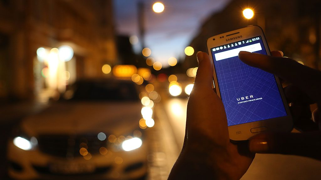 BERLIN, GERMANY - SEPTEMBER 02:  In this photo illustration, a woman uses the Uber app on an Samsung smartphone on September 2, 2014 in Berlin, Germany. Uber, an app that allows passenger to buy rides from drivers who do not have taxi permits, has had its UberPop freelance driver service banned in Germany after a complaint by Taxi Deutschland, a trade association of taxi drivers in the country. The company, which operates in 42 countries over 200 cities worldwide, plans to both appeal the decision made by a court in Frankfurt as well as, at the risk of heavy fines, continue its services in Germany until a final decision has been made on the matter.  (Photo by Adam Berry/Getty Images)