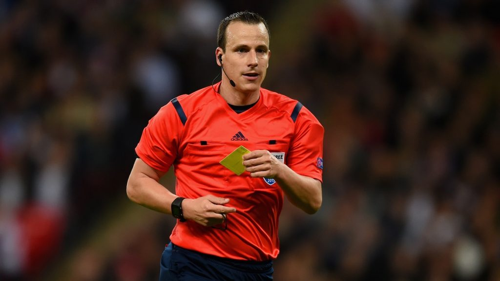 LONDON, ENGLAND - OCTOBER 09: Referee Istvan Vad pulls out the yellow card during the UEFA EURO 2016 Group E Qualifier match between England and Estonia at Wembley Stadium on October 9, 2015 in London, United Kingdom.  (Photo by Michael Regan - The FA/The FA via Getty Images)