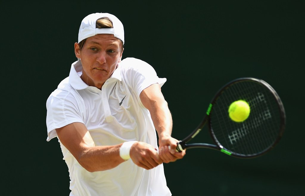 LONDON, ENGLAND - JULY 05:  Mate Valkusz of Hungary in action during the Boy's Singles Second round match against Luke Hammond of Great Britain on day eight of the  Wimbledon Lawn Tennis Championships at the All England Lawn Tennis and Croquet Club on July 5, 2016 in London, England.  (Photo by Shaun Botterill/Getty Images)