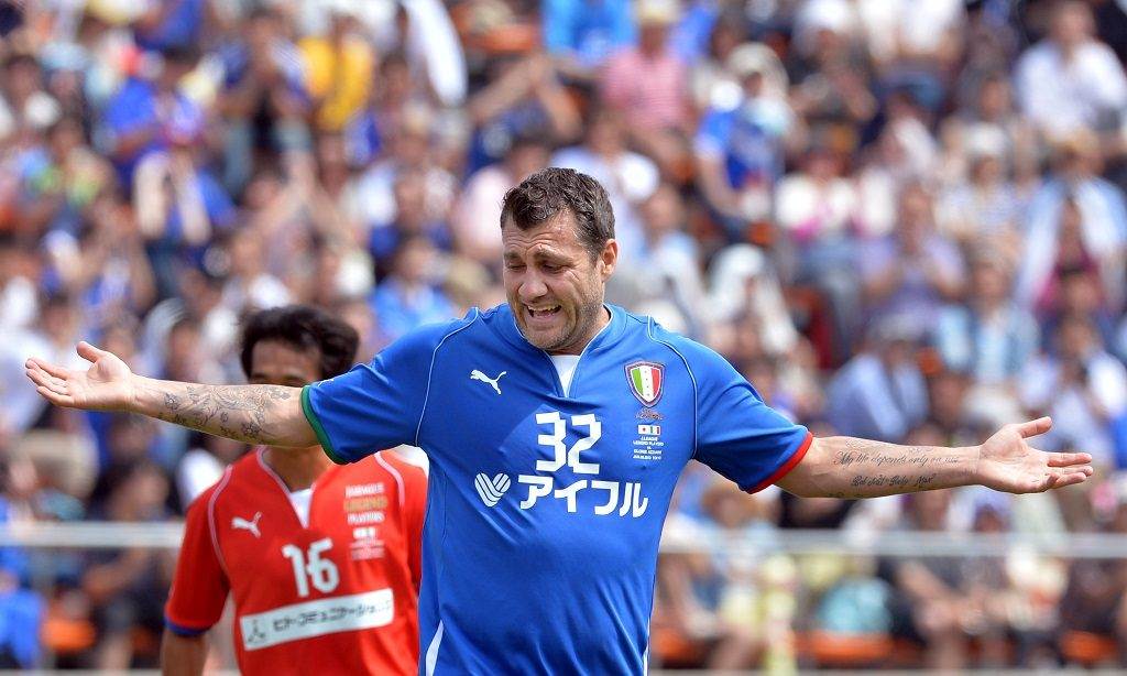 Italy's Gloria Azzurre forward Christian Vieri (R) reacts after his second goal against Japan's J League Legend team during an exhibition football match at the National Stadium in Tokyo on June 9, 2013. The game was drawn at 2-2.      AFP PHOTO / KAZUHIRO NOGI / AFP PHOTO / KAZUHIRO NOGI
