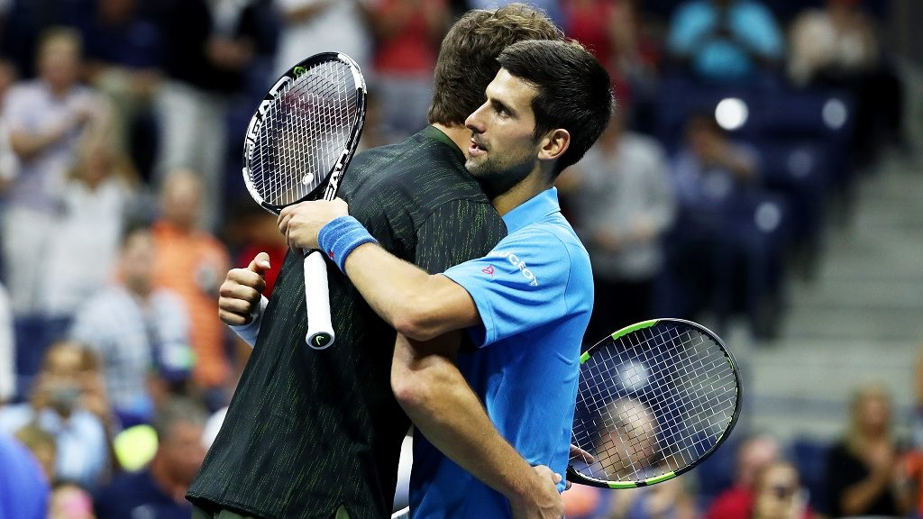 NEW YORK, NY - AUGUST 29: Novak Djokovic of Serbia & Montenegro embraces Jerzy Janowicz of Poland after defeating him during his first round Men's Singles match on Day One of the 2016 US Open at the USTA Billie Jean King National Tennis Center on August 29, 2016 in the Flushing neighborhood of the Queens borough of New York City.   Al Bello/Getty Images/AFP / AFP PHOTO / GETTY IMAGES NORTH AMERICA / AL BELLO