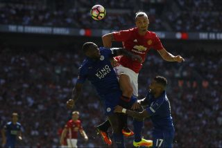 Manchester United's Swedish striker Zlatan Ibrahimovic (C) beats Leicester City's English defender Wes Morgan (L) to a header during the FA Community Shield football match between Manchester United and Leicester City at Wembley Stadium in London on August 7, 2016.  / AFP PHOTO / Ian Kington / NOT FOR MARKETING OR ADVERTISING USE / RESTRICTED TO EDITORIAL USE