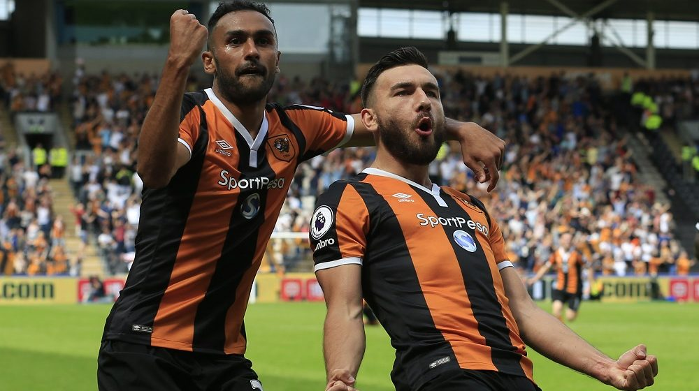 Hull City's Scottish midfielder Robert Snodgrass (R) celebrates with Hull City's Egyptian midfielder Ahmed Elmohamady (L) after scoring their second goal during the English Premier League football match between Hull City and Leicester City at the KCOM Stadium in Kingston upon Hull, north east England on August 13, 2016. / AFP PHOTO / Lindsey PARNABY / RESTRICTED TO EDITORIAL USE. No use with unauthorized audio, video, data, fixture lists, club/league logos or 'live' services. Online in-match use limited to 75 images, no video emulation. No use in betting, games or single club/league/player publications.  /