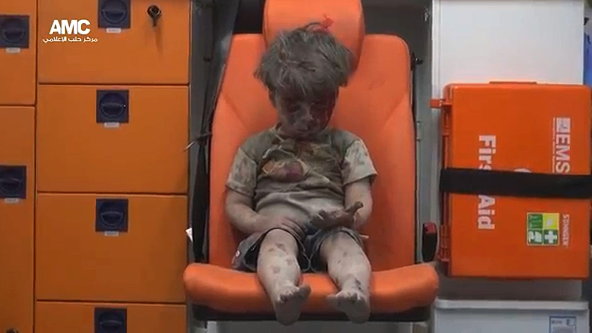 "An image grab taken from a video uploaded by the Syrian opposition's activist group Aleppo Media Centre (AMC) on August 17, 2016 is said to show Omran, a four-year-old Syrian boy covered in dust and blood, looking at his hand in shock as he sits in an ambulance after being rescued from the rubble of a building hit by an air strike in the rebel-held Qaterji neighbourhood of the northern Syrian city of Aleppo. / AFP PHOTO / AMC / HO / === RESTRICTED TO EDITORIAL USE - MANDATORY CREDIT ""AFP PHOTO / HO / AMC "" - NO MARKETING NO ADVERTISING CAMPAIGNS - DISTRIBUTED AS A SERVICE TO CLIENTS FROM ALTERNATIVE SOURCES, AFP IS NOT RESPONSIBLE FOR ANY DIGITAL ALTERATIONS TO THE PICTURE'S EDITORIAL CONTENT, DATE AND LOCATION WHICH CANNOT BE INDEPENDENTLY VERIFIED ===   /"