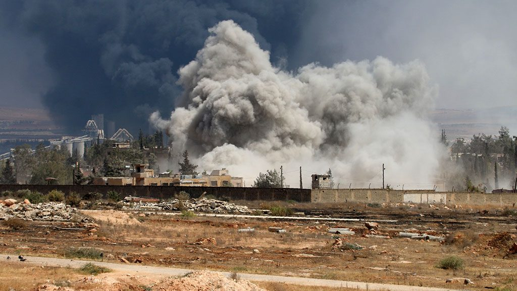 """Smoke billows following air strikes by regime forces on rebel positions during intense fighting in Aleppo on August 18, 2016. Southern Aleppo has been the scene of intense fighting since July 31, when the """"Army of Conquest"""" alliance launched a major offensive to break a regime siege of opposition-controlled districts in the city's east. / AFP PHOTO / GEORGE OURFALIAN"""