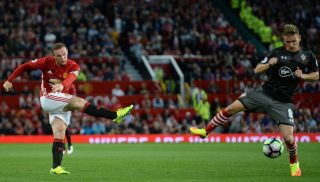Manchester United's English striker Wayne Rooney (L) has an unsuccessful shot during the English Premier League football match between Manchester United and Southampton at Old Trafford in Manchester, north west England, on August 19, 2016. / AFP PHOTO / Oli SCARFF / RESTRICTED TO EDITORIAL USE. No use with unauthorized audio, video, data, fixture lists, club/league logos or 'live' services. Online in-match use limited to 75 images, no video emulation. No use in betting, games or single club/league/player publications.  /