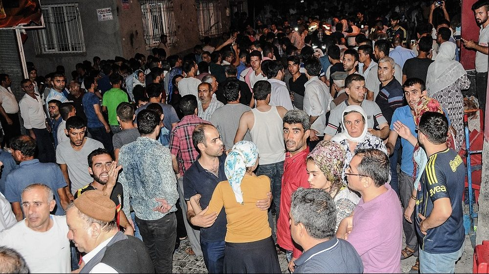 People gather near the explosion site on August 20, 2016 in Gaziantep following a late night militant attack on a wedding party in southeastern Turkey.  The governor of Gaziantep said 22 people are dead and 94 injured in the late night militant attack.  / AFP PHOTO / STR