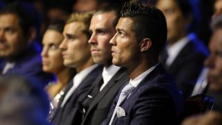 Real Madrid's Portuguese forward Cristiano Ronaldo looks on during the UEFA Champions League Group stage draw ceremony, on August 25, 2016 in Monaco. / AFP PHOTO / Valery HACHE