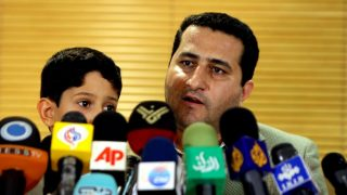 """Iranian nuclear scientist Shahram Amiri addresses journalists upon his arrival at Imam Khomeini Airport in Tehran on July 15, 2010. Amiri, who claimed he was """"abducted"""" by US spies last year, denied that he was a nuclear scientist, but said he was questioned by Israelis during his """"harsh"""" captivity.  Amiri had gone missing from Saudi Arabia in June 2009 while on a pilgrimage and surfaced in Iran's Interests Section in Washington on July 13, 2010.  Upon his arrival in Tehran he immediately told reporters that he was just a """"simple researcher"""". Iranian officials claim he was kidnapped by the Central Intelligence Agency of the United States. US officials have denied these accusations. AFP PHOTO / ATTA KENARE / AFP PHOTO / ATTA KENARE"""