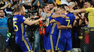 2920669 08/24/2016 Rostov players celebrate a goal during the 2016-17 UEFA Champions League playoff round's 2nd match between Rostov Rostov-on-Don (Russia) and Ajax Amsterdam (Netherlands). Sergey Pivovarov/Sputnik