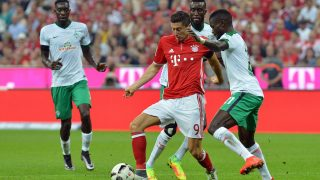 MUNICH, GERMANY - AUGUST 26:  Robert Lewandowski (C) of Munich and Fallou Diagne (R) of Werder Bremen fight for the ball during the Bundesliga soccer match between Bayern Munich and Werder Bremen at the Allianz Arena in Munich, Germany on August 26, 2016. Joerg Koch / Anadolu Agency