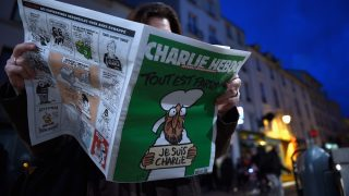 SAINT GERMAIN EN LAYE, FRANCE - JANUARY 14:  A woman reads Charlie Hebdo on January 14, 2015 in Saint Germain en Laye, France. Three million copies of the controversial magazine have been printed in the wake of last week's terrorist attacks.  (Photo by Pascal Le Segretain/Getty Images)
