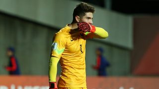 PUERTO MONTT, CHILE - OCTOBER 29:  Goalkeeper Luca Zidane #1 of France bites the tape on his glove after France lost to Costa Rica 5-3 by penalty kick shootout in the France v Costa Rica: Round of 16 - FIFA U-17 World Cup Chile 2015 match at Estadio Chinquihue on October 29, 2015 in Puerto Montt, Chile.  (Photo by Victor Decolongon - FIFA/FIFA via Getty Images)
