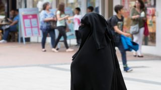 GERMANY, BAD GODESBERG - JUNE 23:  Bad Godesberg, district of Bonn, formerly diplomatic quarter and until now home to many beautiful villas, with a high degree of foreign roommate. The photo shows a muslima wearing a burka. (Photo by Ulrich Baumgarten via Getty Images)