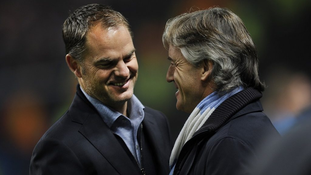 AFC Ajax coach Frank De Boer greets Manchester City team manager Roberto Mancini before the UEFA Champions League Group D match between Manchester City and AFC Ajax of Amsterdam at the City of Manchester Stadium in Manchester, UK. Photo: Visionhaus/Gary Prior (Photo by Ben Radford/Corbis via Getty Images)