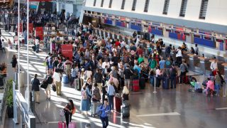 BOSTON - AUGUST 8: There was a crowd near Delta's check-in counters at Boston Logan International Airport after Delta Airlines grounded its U.S. and international flights on Monday, August 8, 2016. A power outage in Atlanta led to the airlines systems going down, according to a news release from the airline. (Photo by Dina Rudick/The Boston Globe via Getty Images)