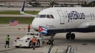 FORT LAUDERDALE, FL - AUGUST 31:   JetBlue Flight 387 pushes back from the gate as it prepares for take off to become the first scheduled commercial flight to Cuba since 1961 on August 31, 2016 in Fort Lauderdale, Florida. JetBlue which hopes to have as many as 110 daily flights is the first U.S. airline to resume regularly scheduled airline service under new rules allowing Americans greater access to Cuba.  (Photo by Joe Raedle/Getty Images)
